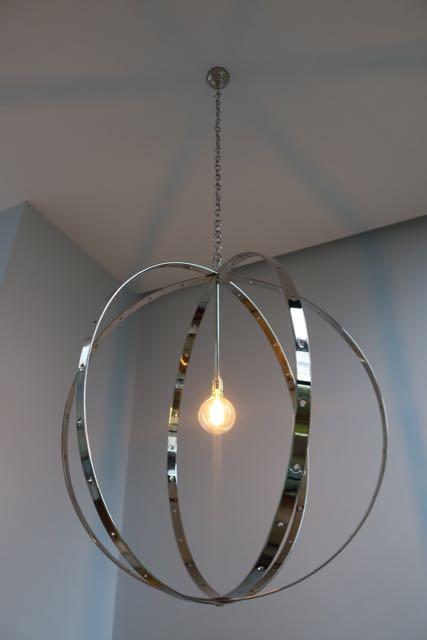 Nickel plated steel ball chandelier.