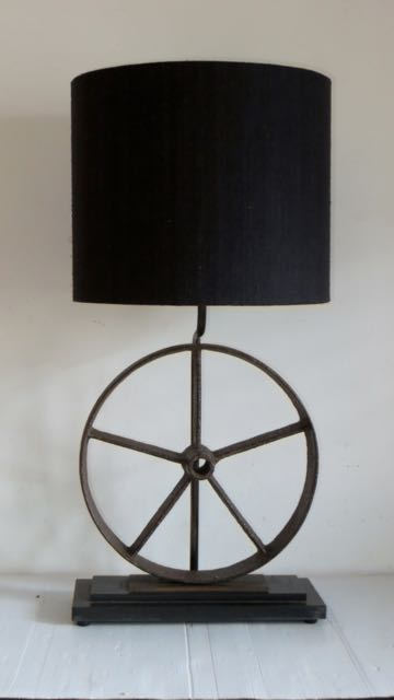Picture of Old cast wheel lamp