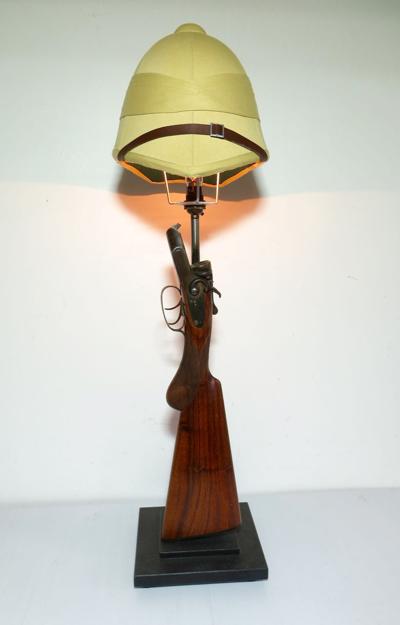 Old hammer gun with pith helmet shade