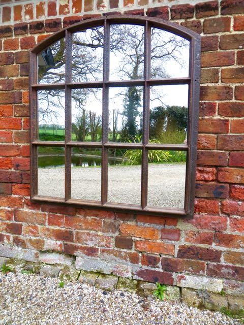 Cast iron slow arch window mirror