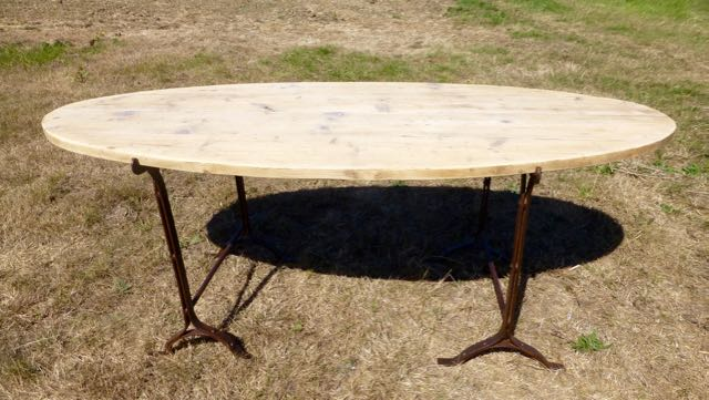 Distressed oval pine trestle table