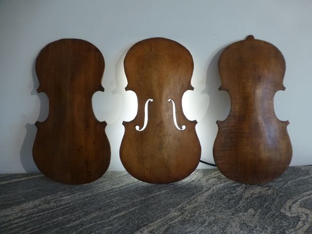 Picture of 2 backs & 1 front of a violin wall sconces.