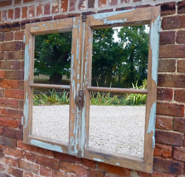 Old French window with blue paint