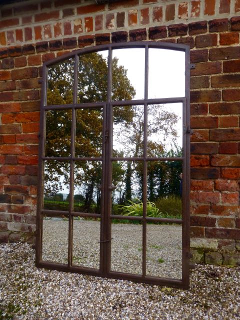 Cast iron slow arch window mirror