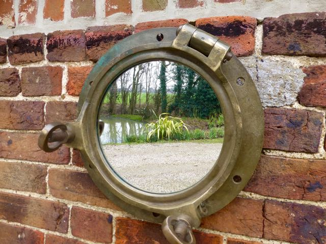 Picture of Large brass port hole mirror