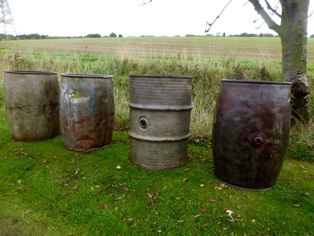 Picture of 4 old metal barrels