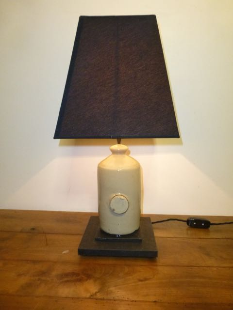 Clay hot water bottle table lamp.