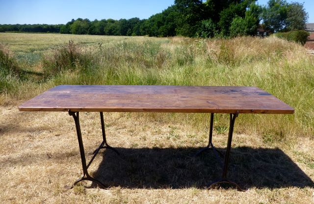 Picture of Trestle table with old floor board top