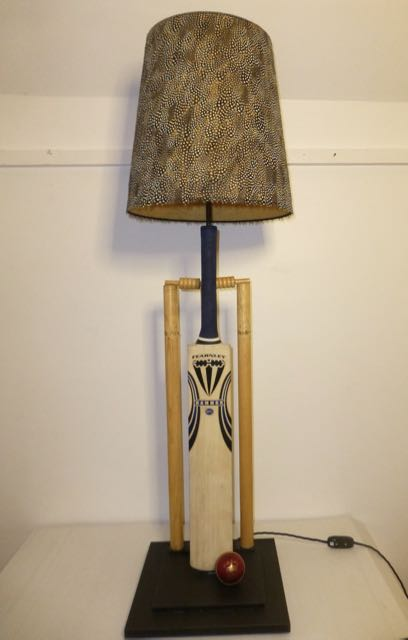 Picture of Cricket bat and stumps lamp.