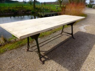 Oak distressed top and industrial base table.