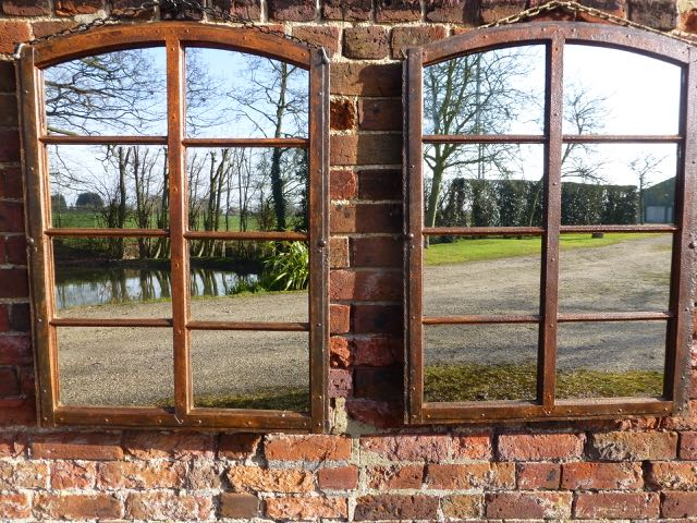 Pair of slow arched window mirrors