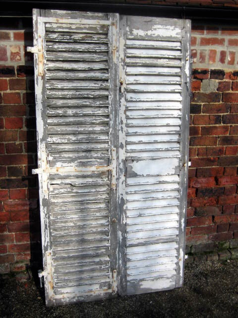 Pair of distresed French shutters