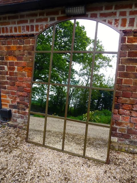 Picture of One of a pair of slow arch window mirrors