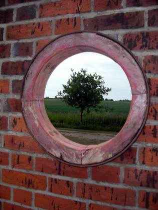 Picture of Old barrow wheel mirror